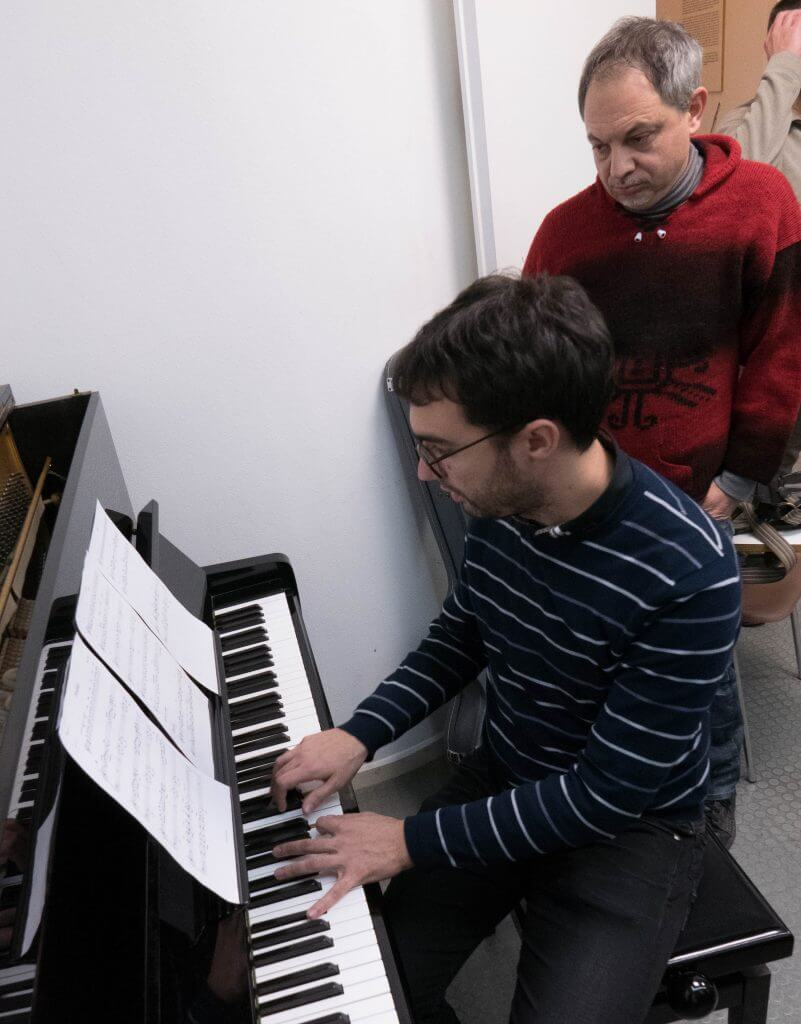 Luca Ridolfo with a student showing how to play