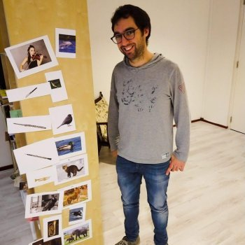 Luca Ridolfo with pictures of instruments and animals game